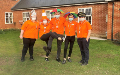 Recreation and Well-Being staff posing in their new uniform at Princess Christian Care Home