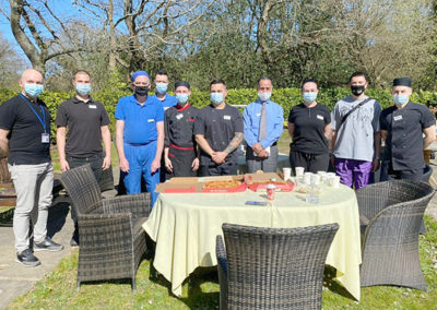 The Kitchen team at Princess Christian Care Home outside with Manager Mario