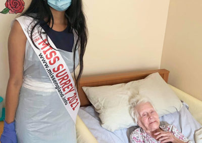 Miss Surrey visiting a resident in her room at Princess Christian Care Home
