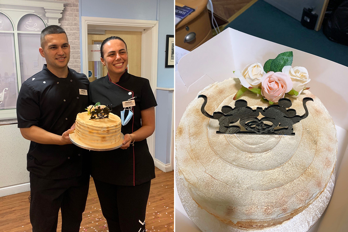 Two staff members at Princess Christian Care Home with a wedding celebration cake