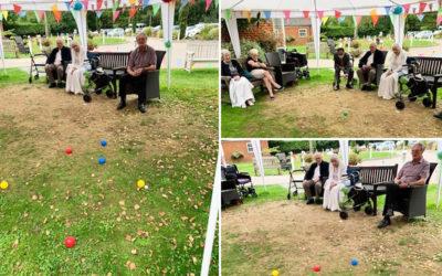Residents enjoy garden boules at Princess Christian Care Home